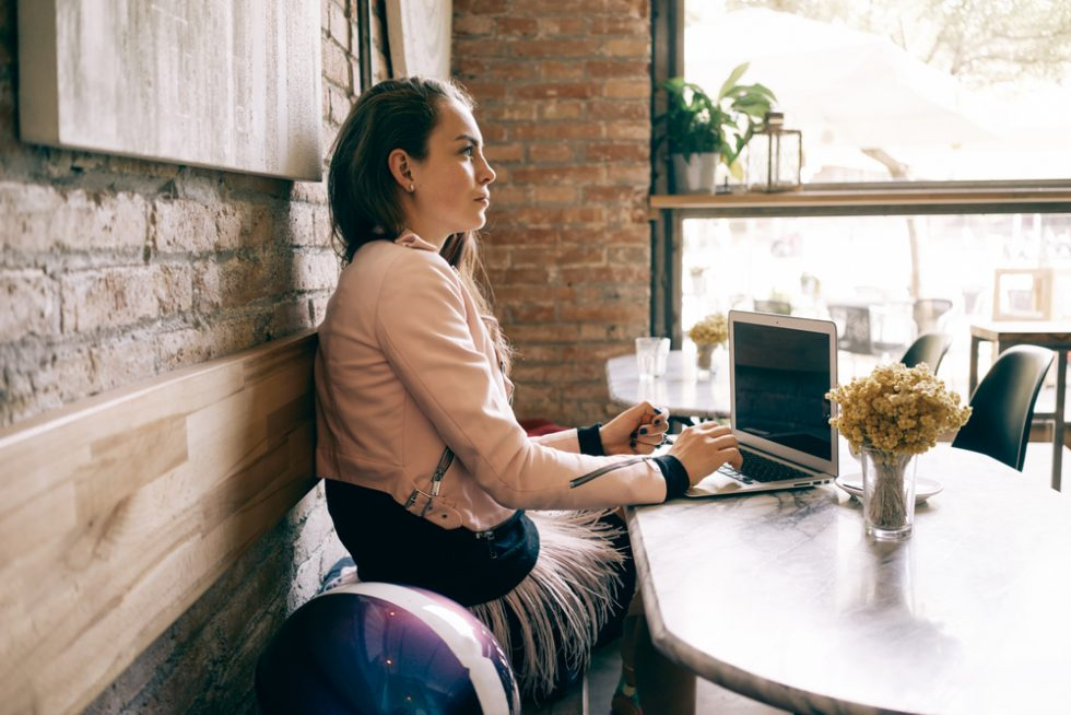 Woman sitting with laptop